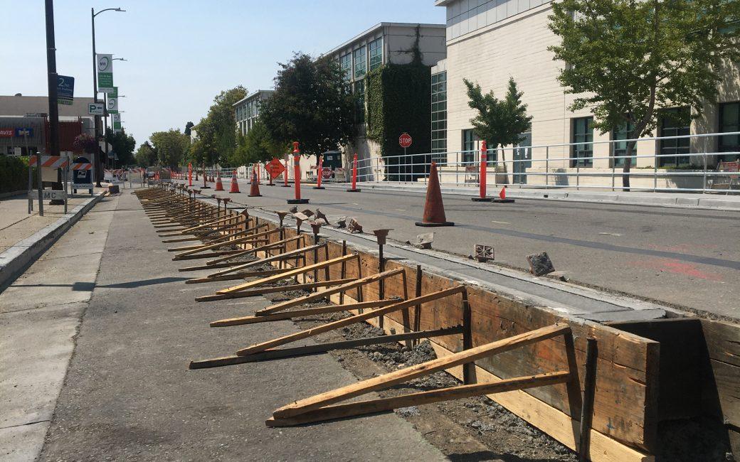 Protected bike lanes under construction on Milvia St in Berkeley, CA